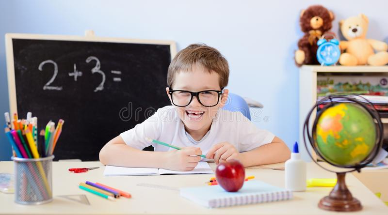 years old boy solves multiplication table his copybook back to school 75855327