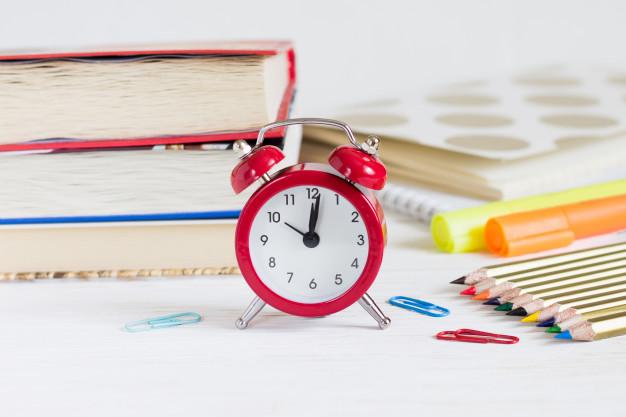 exam concept red alarm clock books color pencils back school concept 101969 456