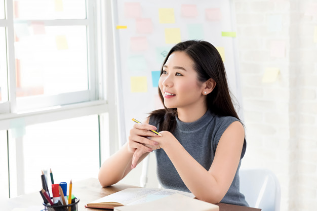 young asian female student thinking table 8087 308